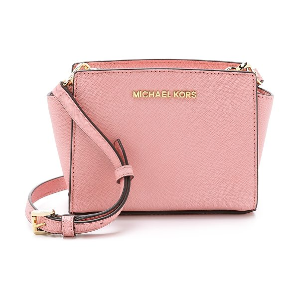 MICHAEL Michael Kors Selma mini messenger bag in pale pink - A structured, saffiano leather MICHAEL Michael Kors...