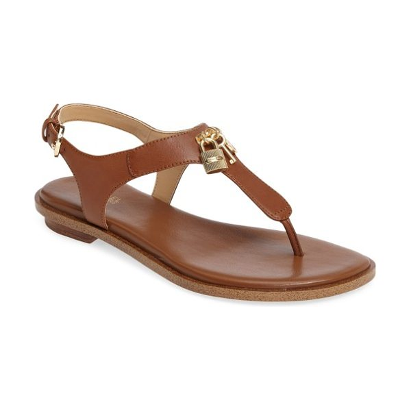 MICHAEL Michael Kors suki t-strap charm sandal in brown - Lock, key and logo charms dance playfully at the T-strap...