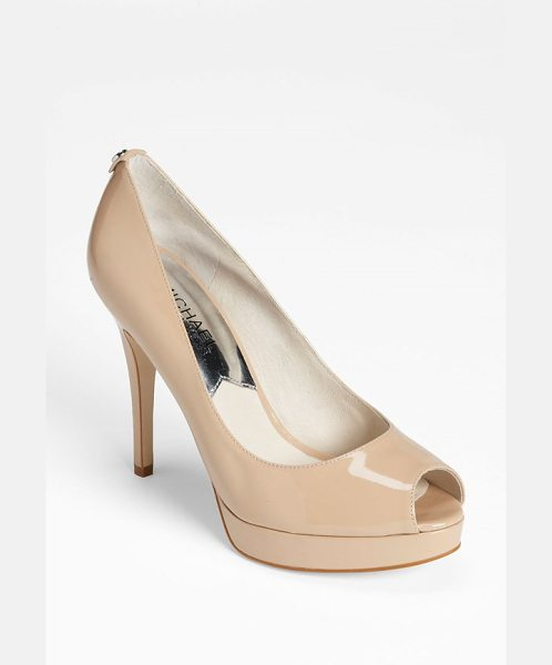 MICHAEL Michael Kors york platform in nude - Logo-embossed hardware subtly details the back of a...