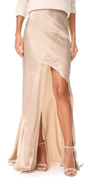 Michelle Mason bias maxi skirt in champagne - A deep front slit adds a flirty touch to this...