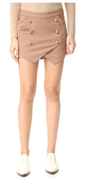 MICHELLE MASON military miniskirt in tan - Polished buttons accent the crossover panels on this...