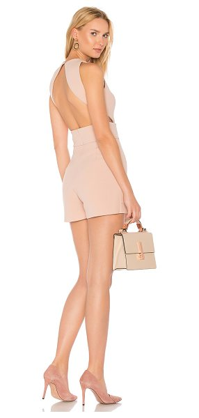 "MISHA COLLECTION Clara Romper in blush - ""Poly blend. Dry clean only. Draped skirt overlay. Back..."