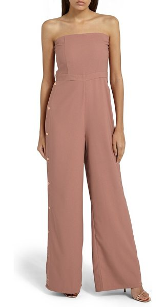 MISSGUIDED strapless jumpsuit in pink - Golden snaps accentuate the wide, fluid legs of this...