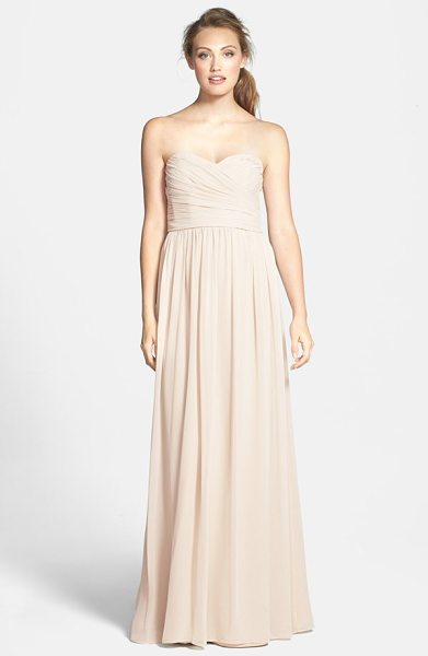 ML Monique Lhuillier Bridesmaids strapless ruched chiffon sweetheart gown in champagne - A floating chiffon skirt enhances the elongated...