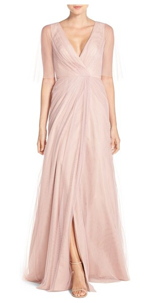 Monique Lhuillier Bridesmaids sheer capelet v-neck tulle a-line gown in shell - Gathered to the front waist for the illusion of wrapped...