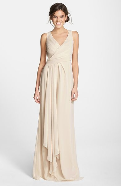 Monique Lhuillier Bridesmaids sleeveless v-neck chiffon gown in champagne - A pleat-softened bodice with a pretty crossover neckline...