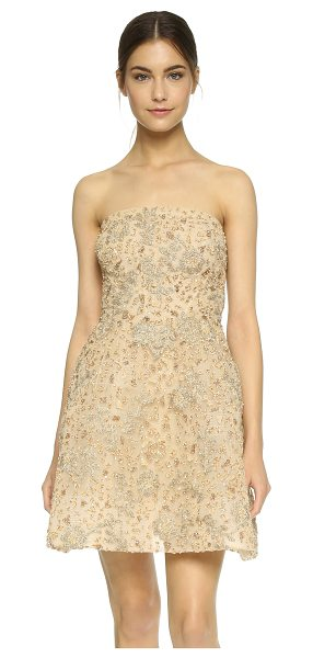 Monique Lhuillier Bridesmaids Structured strapless dress in gold - Sparkling beadwork and metallic embroidered flowers lend...