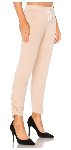 Monrow French Terry Jogger in pink - Cotton blend. Elasticized drawstring waist. Side slant...