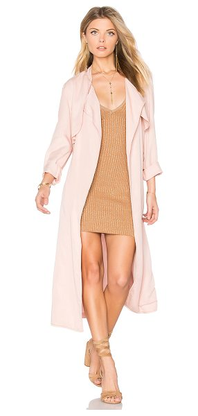 Monrow Long Trench Coat in pink - 100% tencel. Open front. Storm flap. Belted waist. Back...