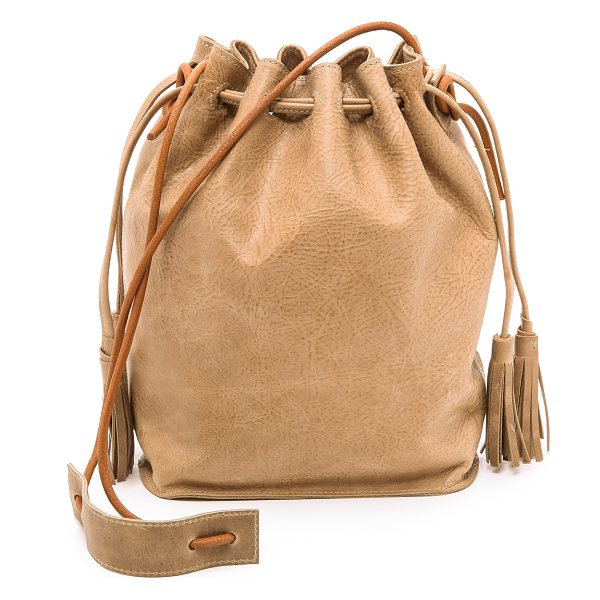 Monserat De Lucca Sancha drawstring bucket bag in beige - Distressed leather brings a well worn look to this...