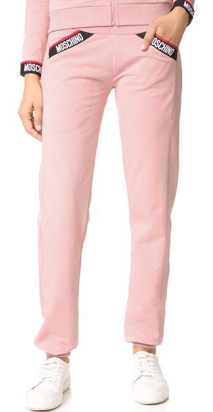 Moschino joggers in pink - Fleece Moschino sweatpants, detailed with branded...