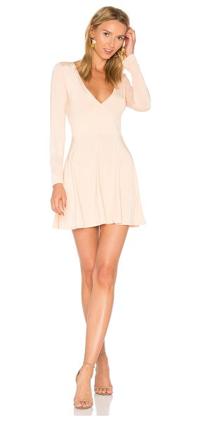 Motel Ingrid Dress in peach - 90% poly 10% elastane. Hand wash. Unlined. Crossover...