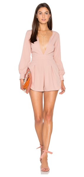 Motel Millicent Romper in blush - 100% poly. Hand wash cold. Back zipper closure. Side...
