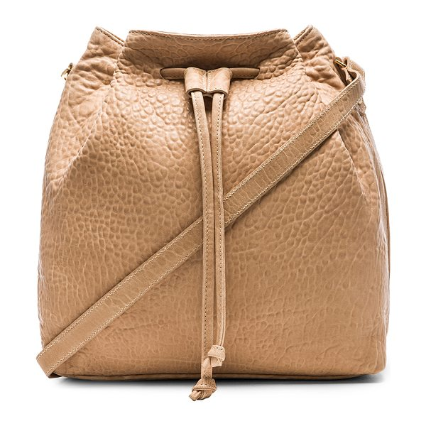 MR. Baker bucket crossbody rose in rose - Leather exterior with poly fabric lining. Measures...