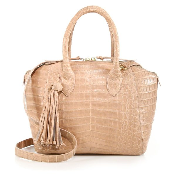 Nancy Gonzalez Small tasseled crocodile satchel in nude - A round, structured shape crafted of luxe crocodile and...