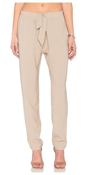 NATIVE STRANGER Drawstring drapey pant in beige - Viscose blend. Dry clean only. Elastic drawstring waist....