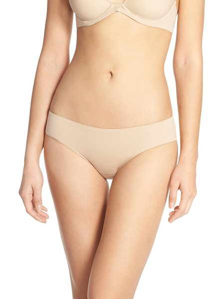 Natori aura tanga briefs in nude - A supersoft low-rise brief has sleek edges for a smooth...