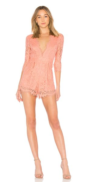 "NBD Warren Romper in coral - ""Self: 55.2% cotton 34.3% nylon 10.5% rayonLining: 97%..."