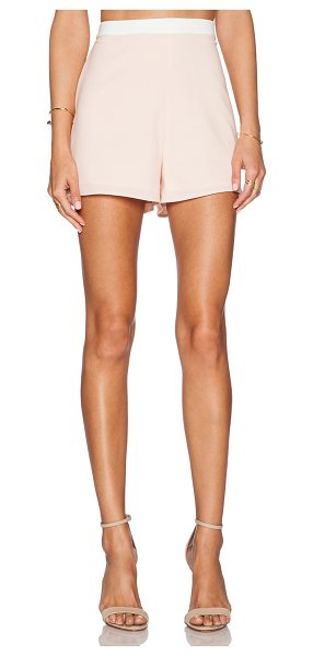 NBD x Naven Twins Last Call Shorts in blush - 98% poly 2% spandex. Hand wash cold. Shorts measure...
