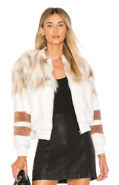 NBD x REVOLVE The Bella Faux Fur Bomber in ivory & blush - Sporty meets luxury in NBD's Bella Faux Fur Bomber. Cut...