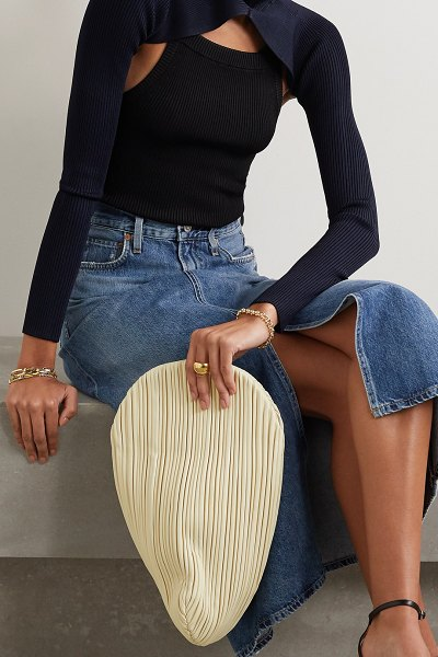 Neous pluto pleated leather clutch in cream