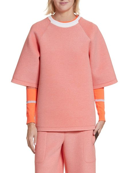 NEVERBEFORE tech tee in coral - Cut from soft heathered tech fleece, this coral-hued...