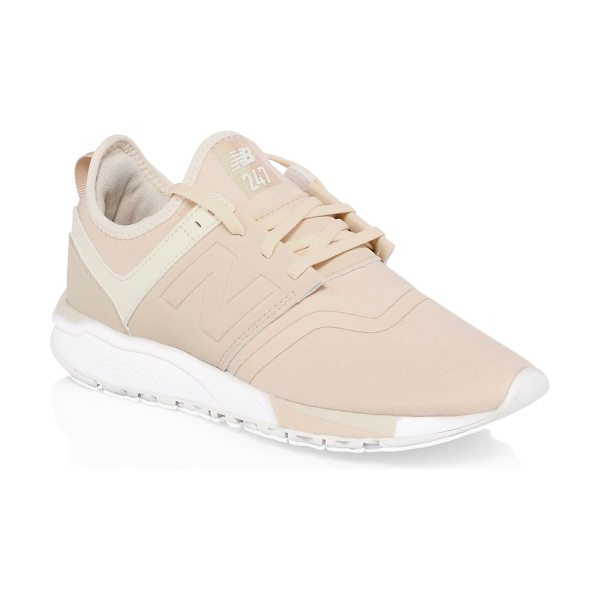 New Balance 247 knit sneakers in tan - Engineered knit sneakers in foot-hugging bootie...