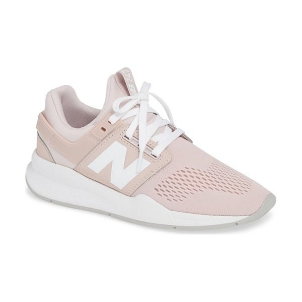 New Balance 247 sneaker in pink - Engineered mesh brings targeted, breathable support to a...