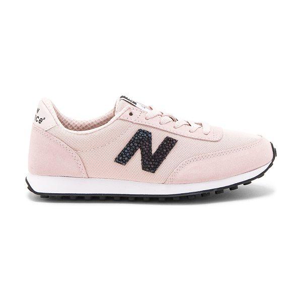 New Balance 410 Sneaker in pink sandstone & white - Textile and suede upper with rubber sole. Lace-up front....