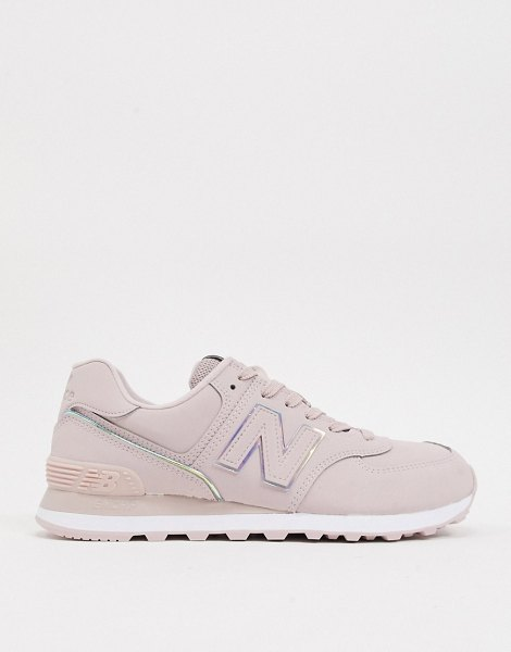 New Balance 574 sneakers in pink with iridescent piping in pink