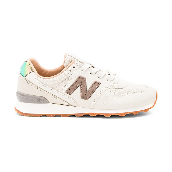 New Balance NB Grey Sneaker in powder & cresent - Leather and textile upper with rubber sole. Lace-up...