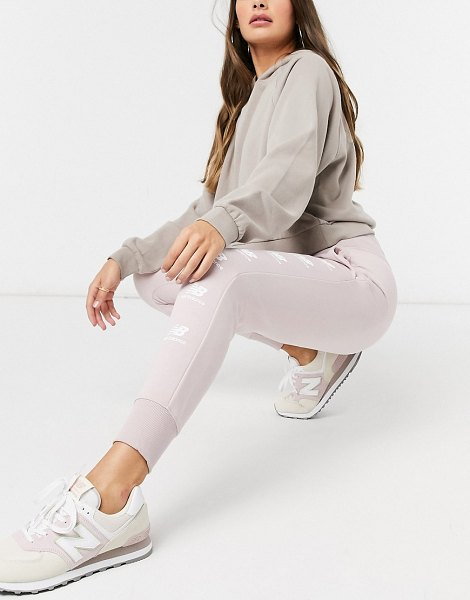 New Balance stacked logo sweatpants in pink in pink