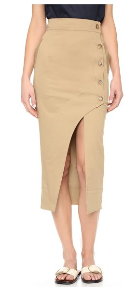 Nicholas N/ curve skirt in tan - A dramatic curve creates a flirty slit on this crisp...
