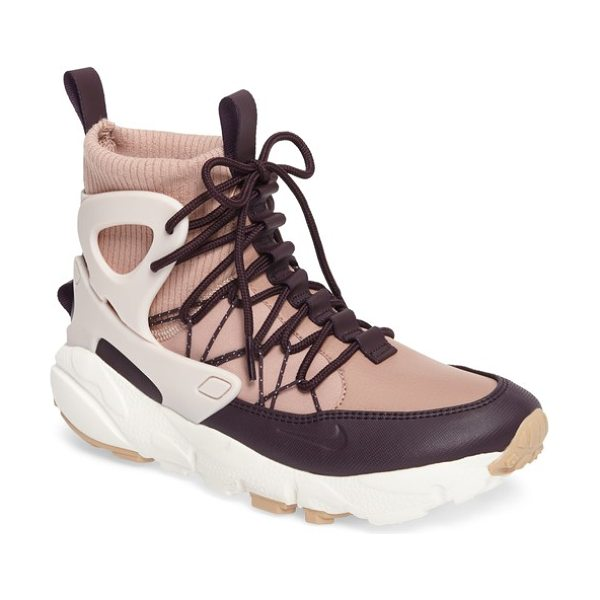 NIKE air footscape mid sneaker boot - This inventively deconstructed sneaker boot starts with...
