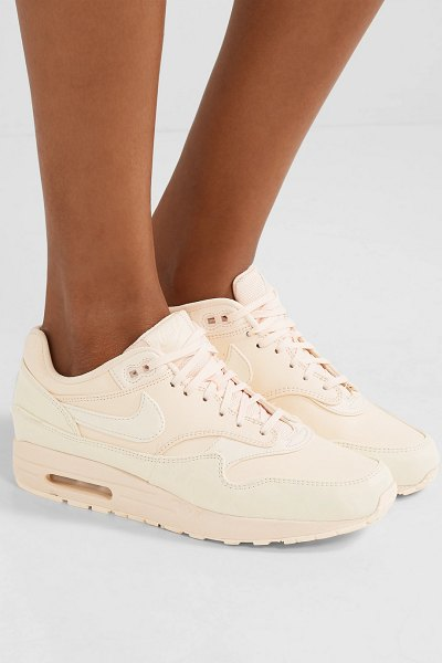 Nike air max 1 reflective logo-print leather and canvas sneakers in blush - Nike was putting its insignia on everything long before...