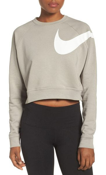 Nike dry versa training crop top in cobblestone/ white - A sweat-wicking top in a cropped silhouette offers...