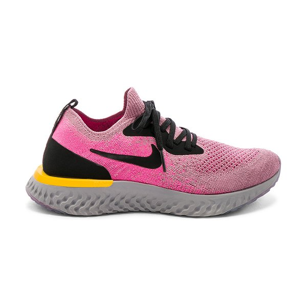 Nike Epic React Flyknit Sneaker in pink - Knit textile upper with rubber sole. Lace-up front....