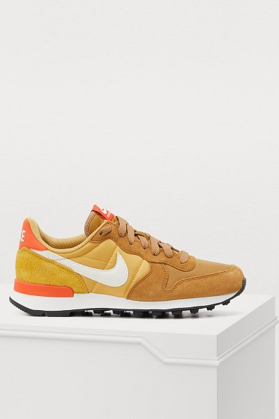 Nike Internationalist sneakers in muted gold / summit white-wheat gold - Sportswear makes an entrance into the urbanite's...