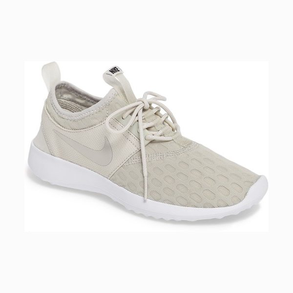 Nike juvenate sneaker in light bone/ black/ white - A streamlined sneaker is engineered to provide a smooth,...