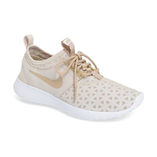 Nike juvenate sneaker in oatmeal/ linen/ white - A streamlined sneaker is engineered to provide a smooth,...