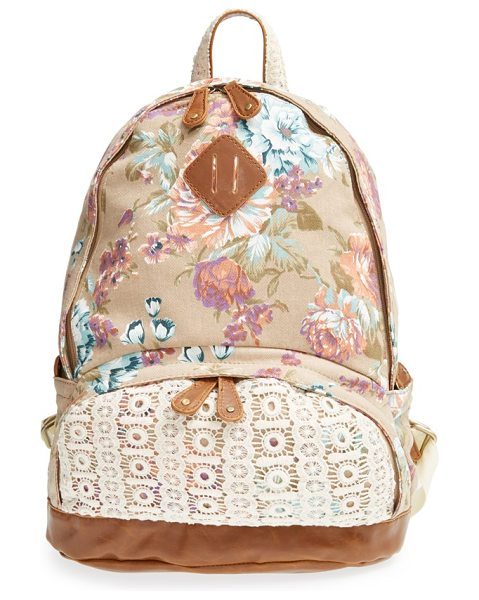 nila anthony Floral print backpack in tan - Lace and faux-leather accents add vintage sophistication...