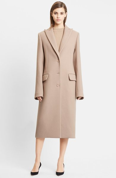 Nina Ricci double face wool coat in camel - Generous proportions, extended sleeves and a sharp peak...