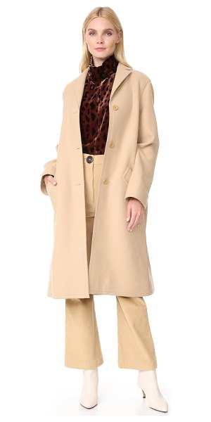 Nina Ricci overcoat in camel - Raised seams add a subtle deconstructed look to this...