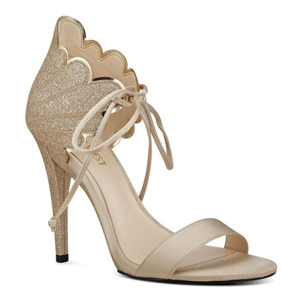 Nine West 'carly' ankle tie sandal in light gold glitter - A wing-like counter characterized by high-shine...
