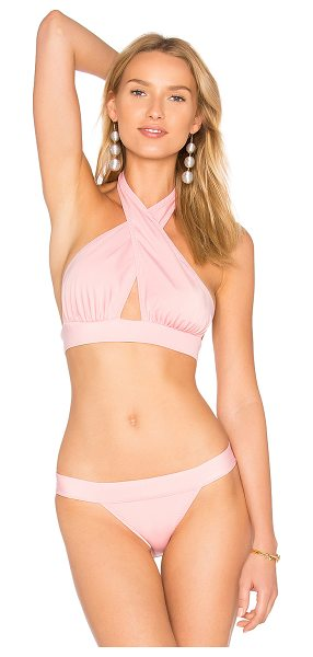 Norma Kamali Cross Halter Bikini Top in pink - Self: 82% nylon 18% spandexLining: 100% nylon. Hand wash...