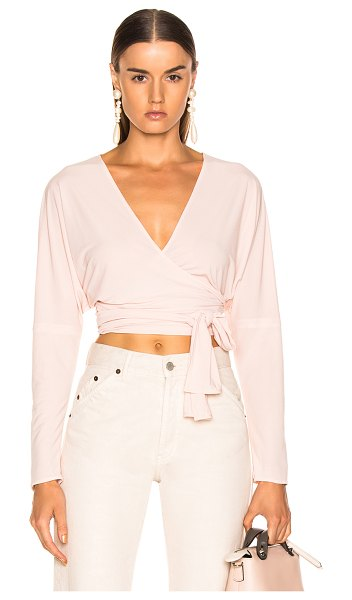 Norma Kamali Long Sleeve Dolman Wrap Top in pink - 100% poly.  Made in USA.  Hand wash.  Wrap around front...