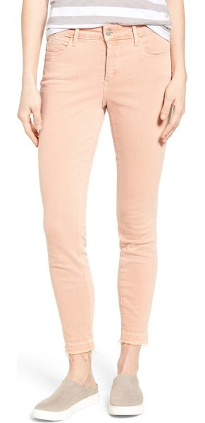 NYDJ ami release hem stretch skinny jeans in pink grapefruit - Frayed release hems complete the lived-in look of...