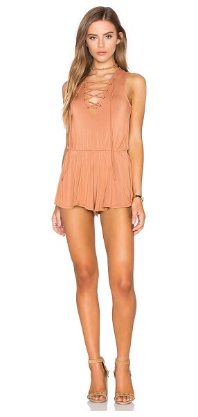 NYTT Nuri Romper in tan - 95% rayon 5% spandex. Hand wash cold. Front lace-up tie...