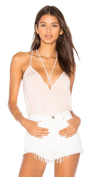 NYTT Strappy Bodysuit in pink - 95% rayon 5% spandex. Hand wash cold. Crisscross straps....