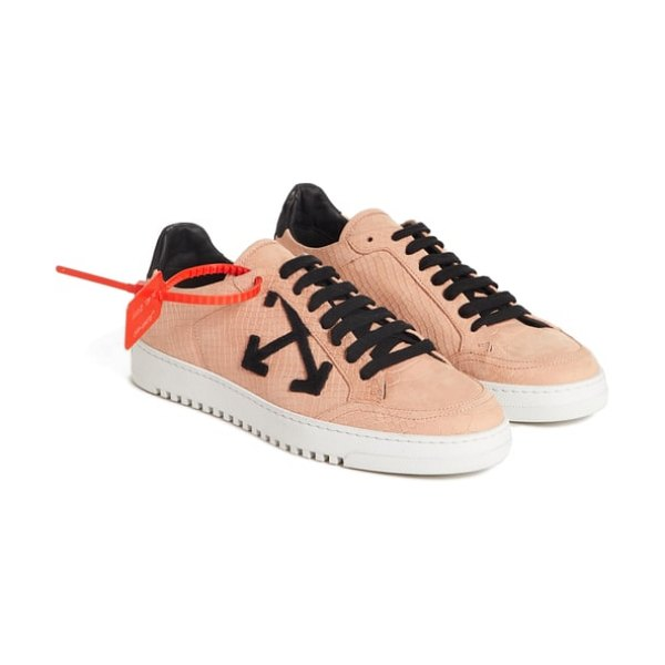 OFF-WHITE arrow sneaker in pink - A snowy bumper sole boosts the exotic street style of...